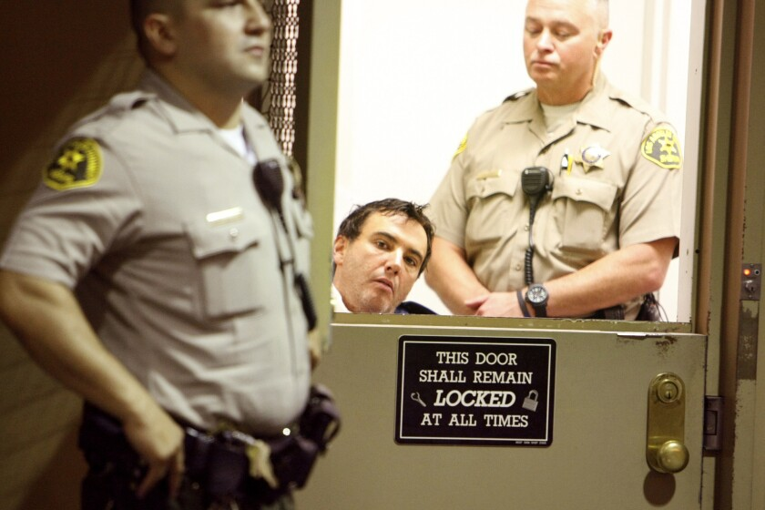 Michael Rodney Kane, shown in a Van Nuys courtroom in 2013, was convicted Monday of stabbing his estranged wife to death.