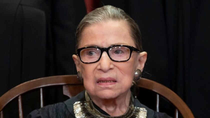 "Justice Ruth Bader Ginsburg warned that the court's ruling would cause ""massive disenfranchisement."""