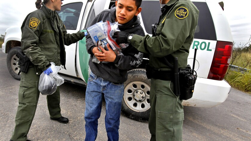 A 17-year-old Guatemalan is removed from a U.S. Border Patrol vehicle south of McAllen, Texas. Although immigration from Central America has increased, the overall number of immigrants living in the U.S. illegally is at its lowest in more than a decade.