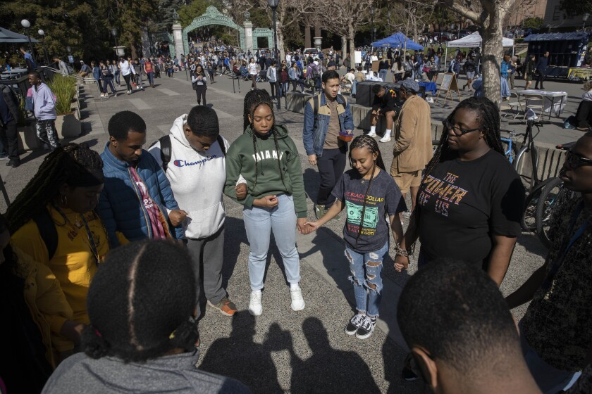 UC Berkeley Black students gather in circle on campus