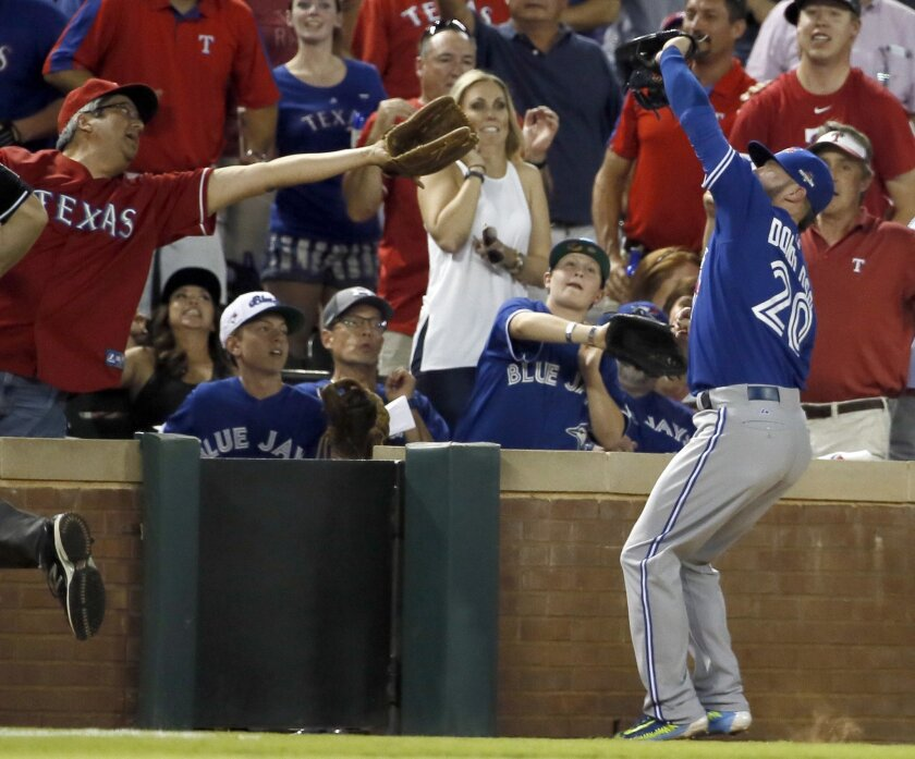 FILE - In this Sunday, Oct. 11, 2015 file photo, Toronto Blue Jays third baseman Josh Donaldson (20) grabs a fly-ball by Texas Rangers right fielder Shin-Soo Choo for an an out during the first inning in Game 3 of baseball's American League Division Series in Arlington, Texas.  The Rangers have ins