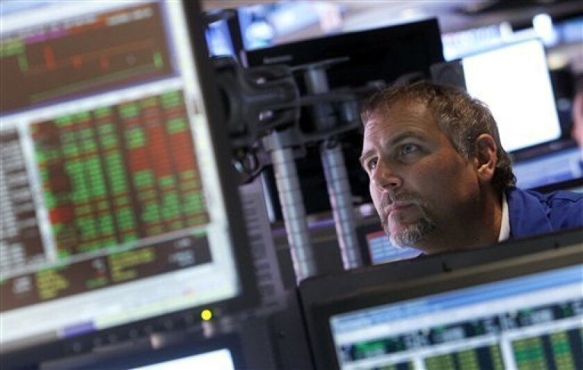 A trader works on the floor of the New York Stock Exchange, Friday, Aug. 31, 2012, in New York. Stocks are giving up some of their gains after comments from Federal Reserve Chairman Ben Bernanke. Bernanke made clear Friday that the Federal Reserve will do more to boost the economy because of high U