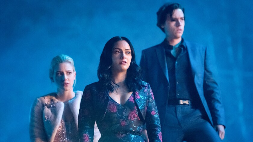 """Lili Reinhart, left, Camila Mendes and Cole Sprouse in """"Riverdale"""" on The CW."""