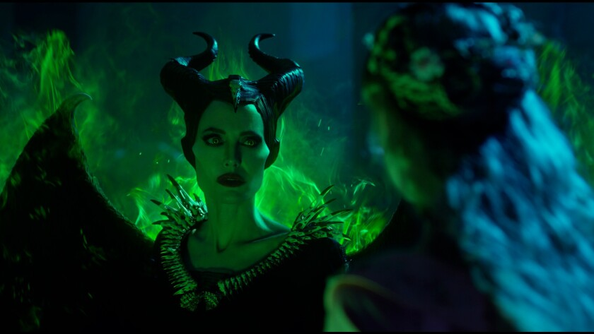 """Angelina Jolie, left, as Maleficent and Elle Fanning as Princess Aurora in """"Maleficent: Mistress of Evil."""""""