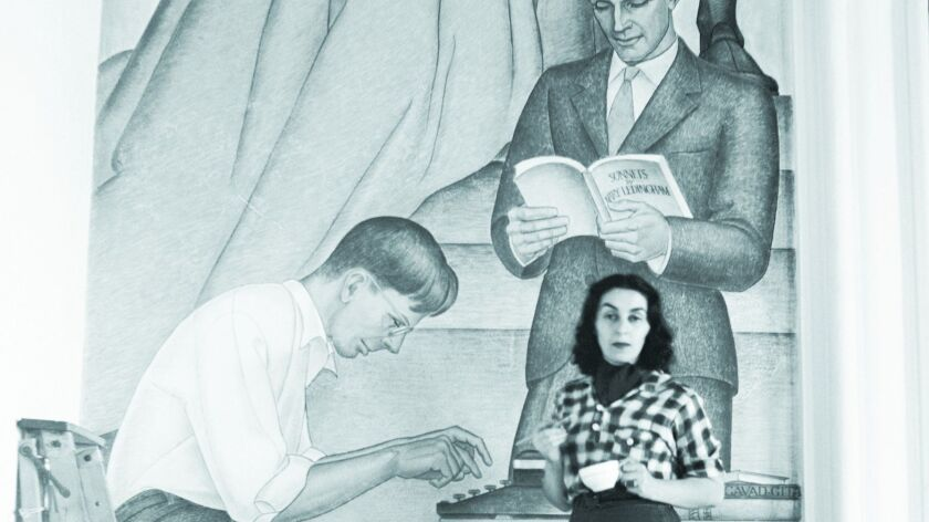 """Belle Baranceanu standing in front of """"The Seven Arts"""" mural in 1940."""