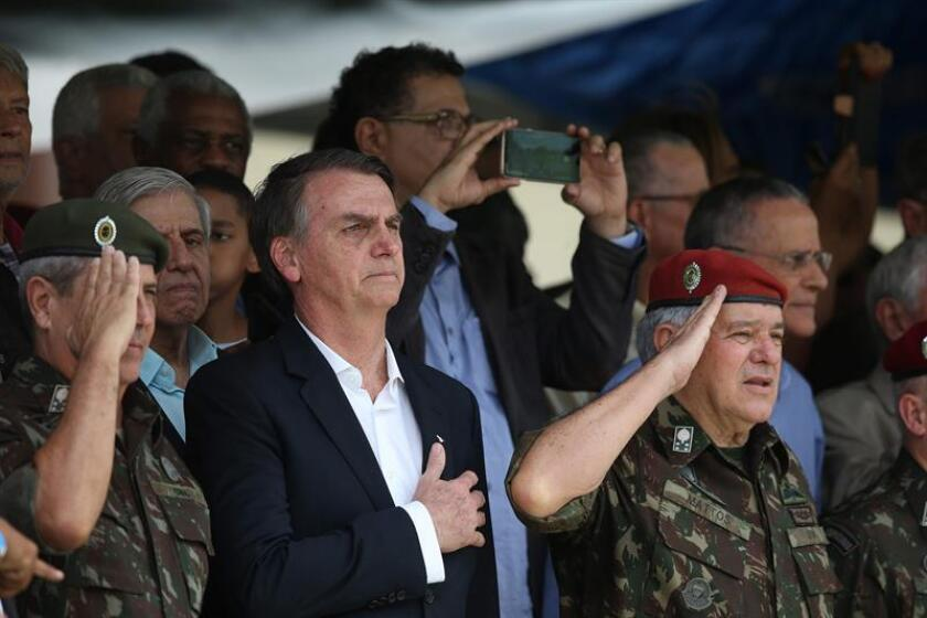 Brazilian President-elect Jair Bolsonaro (center), takes part in a ceremony in Rio de Janeiro, Brazil, to mark the 73rd anniversary of the founding of the Brazilian army's Paratroopers Brigade. EPA-EFE/Marcelo Sayão