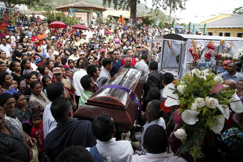 Mourners carry the coffin of slain environmental activist Lesbia Janeth Urquia outside a church in Marcala, Honduras, on July 8.