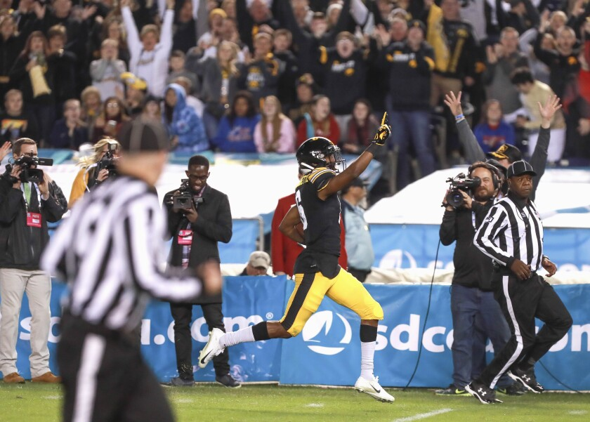 Iowa's Ihmir Smith-Marsette scored on a reception, rush and this 98-yard kickoff return in the first half of the Holiday Bowl on Friday against USC at SDCCU Stadium.
