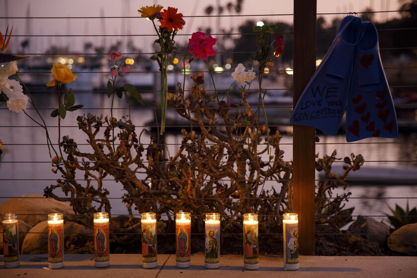 Candles at a makeshift memorial for the Conception boat fire