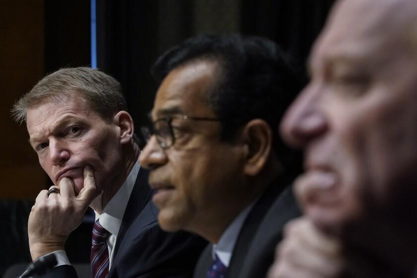 FireEye CEO Kevin Mandia, SolarWinds CEO Sudhakar Ramakrishna and Microsoft President Brad Smith testify during a Senate Intelligence Committee hearing on Capitol Hill on Tuesday, Feb. 23, 2021 in Washington. (Drew Angerer/Photo via AP)