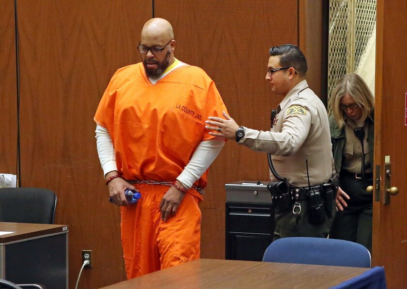 """FILE - In this Oct. 27, 2015 file photo, former rap mogul Marion """"Suge"""" Knight is led into court for his arraignment on robbery charges, in Los Angeles. Knight received a new attorney in a murder case Thursday, Jan. 21, 2016, after his former defense attorney Thomas Mesereau was relieved from the case. (Frederick M. Brown/Pool via AP, File)"""