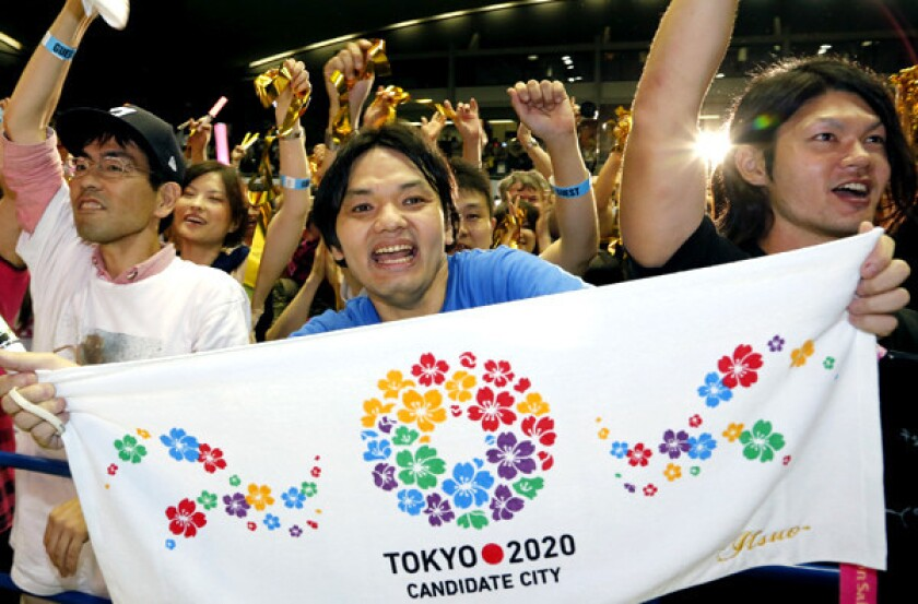 Japanese supporters of the bid for the 2020 Summer Olympic Games celebrate in Tokyo early Sunday morning.