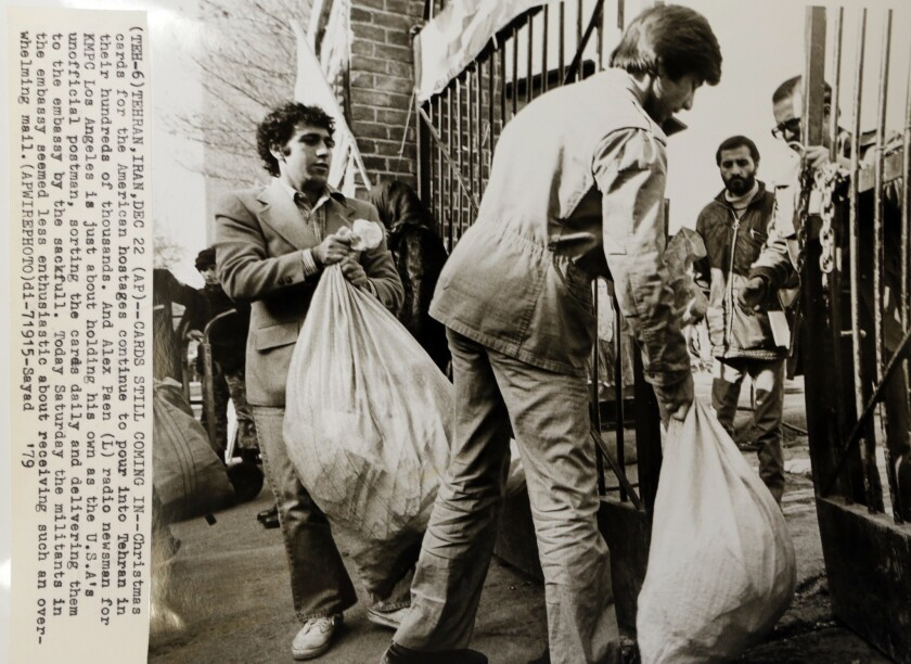 Copy of Associated Press photo of Alex Paen as he delivered Christmas cards for U.S. hostages in Tehran, Iran in 1979.