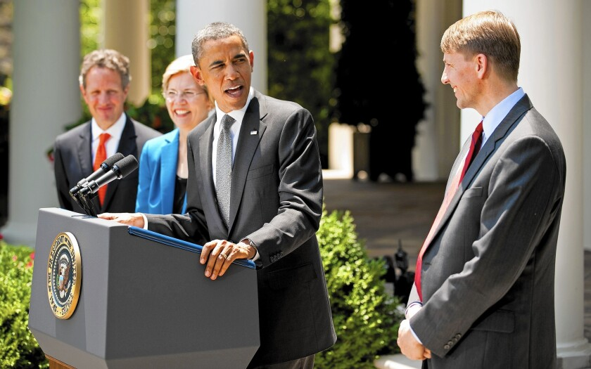 President Obama is shown with Richard Cordray, right, head of the Consumer Financial Protection Bureau. Under preliminary requirements unveiled by the bureau last year, payday lenders would have to determine upfront whether a borrower could repay the loan.