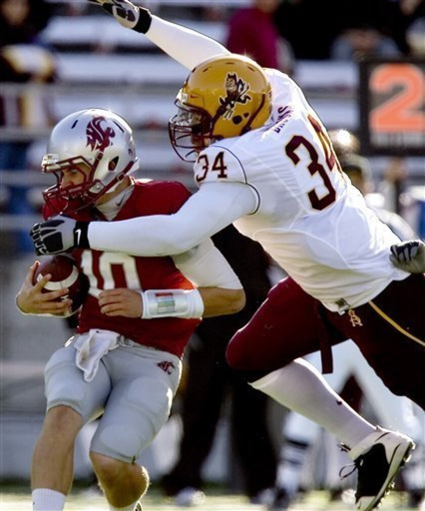 Arizona State defensive end James Brooks (34) sacks Washington State quarterback Jeff Tuel (10) during the first quarter of an NCAA college football game Saturday, Oct. 10, 2009, at Martin Stadium in Pullman, Wash. (AP Photo/Dean Hare)