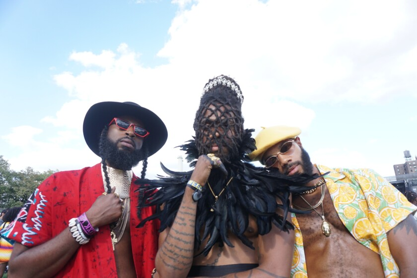 Friends Ivore Rousell, from left, Troy Landry and Walter Kemp pose for photo on Aug. 24, 2019, at Afropunk at Commodore Barry Park in Brooklyn, New York.