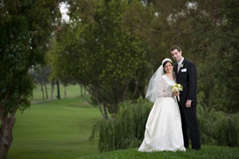 Adriene Christina Giese and Timothy Mark Eastaway at their wedding. Photo/John Riedy Photography