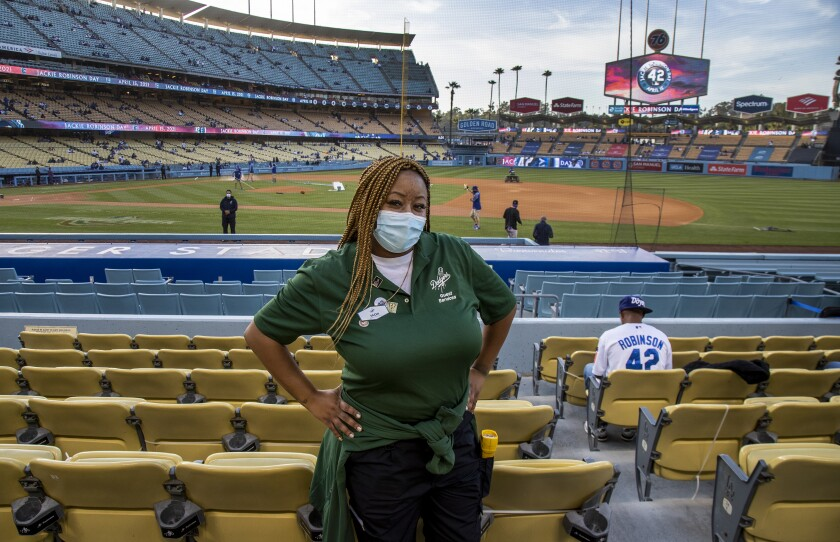 Sachi Hamilton, great-niece of the baseball legend Jackie Robinson, poses in front of the field at Dodger Stadium.