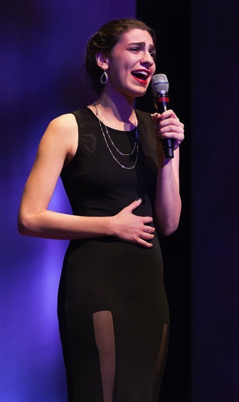 Canyon Crest Academy's Samantha Tullie sings at Heart of a Child.