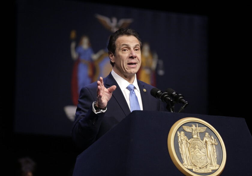 "FILE - In this Feb. 25, 2019 file photo, New York Gov. Andrew Cuomo speaks during a bill signing ceremony in New York. Cuomo says his state will file a lawsuit challenging the Trump administration's plan to block New Yorkers from enrolling in ""trusted traveler"" programs. Federal officials say they took the step because of a new New York law barring immigrant agents from getting access to state motor vehicle records. (AP Photo/Seth Wenig, File)"