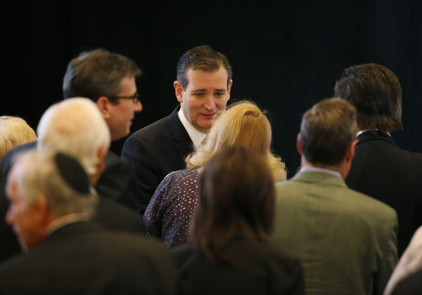 Sen. Ted Cruz of Texas, a Republican presidential candidate, meets with audience members after speaking at the Republican Jewish Coalition meeting Saturday in Las Vegas.