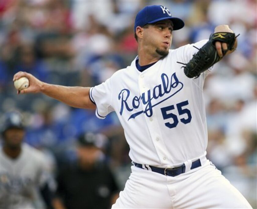 Kansas City Royals starting pitcher Gil Meche throws during the first inning of a baseball game against the Tampa Bay Rays, Thursday, July 24, 2008, in Kansas City, Mo. (AP Photo/Ed Zurga)