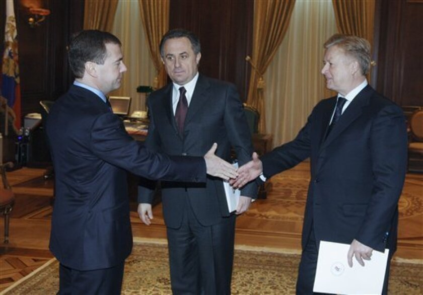 Russian President Dmitry Medvedev, left, meets with Sports and Tourism Minister Vitaly Mutko, center, and Russian Olympics Committee president Leonid Tyagachev at the Gorki presidential residence outside Moscow on Wednesday, Feb. 3, 2010. (AP Photo/RIA Novosti, Mikhail Klimentyev, Presidential Press Service)