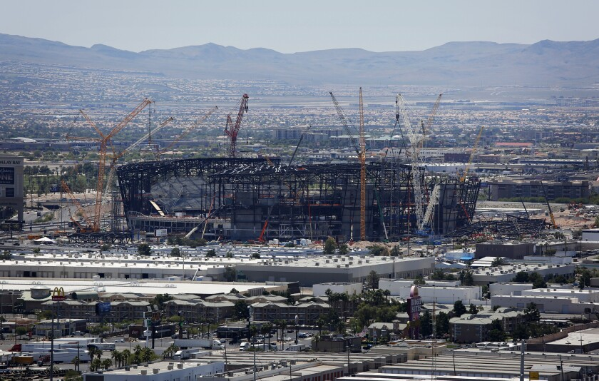 Construction cranes surround the football stadium under construction last month in Las Vegas.