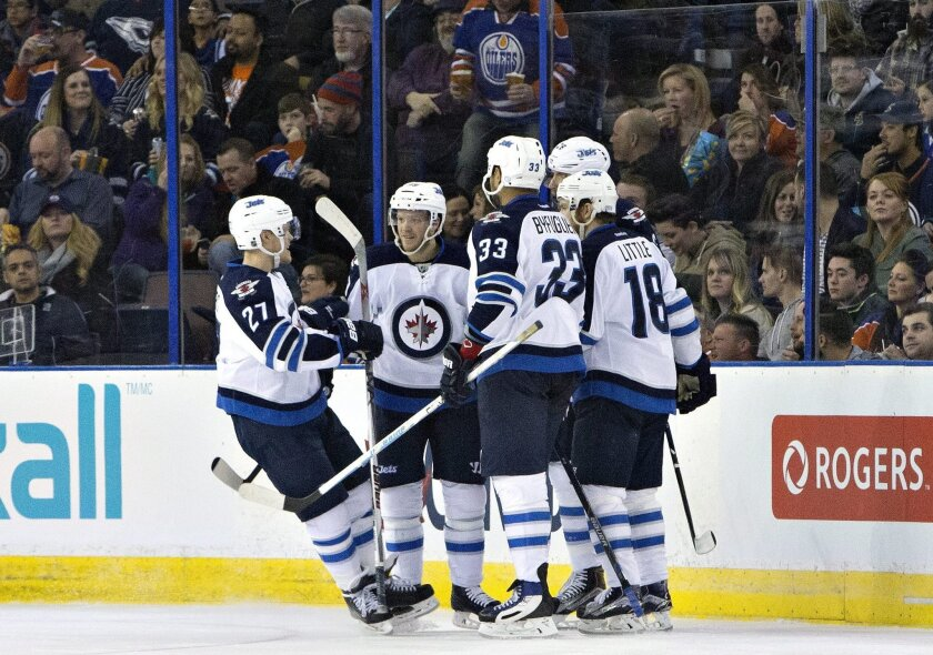 The Winnipeg Jets celebrate a goal against the Edmonton Oilers during the second period of an NHL hockey game Saturday, Feb. 13, 2016, in Edmonton, Alberta. (Jason Franson/The Canadian Press via AP)