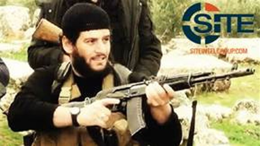 This undated militant image provided by SITE Intel Group shows Abu Muhammad Adnani, the Islamic State militant group's former spokesman.