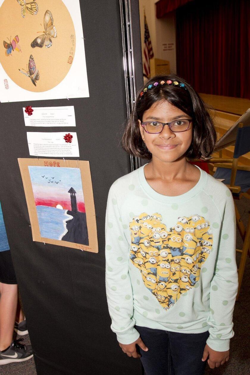 """5th grader Tisha Priyadarshi with her painting """"Hope"""""""