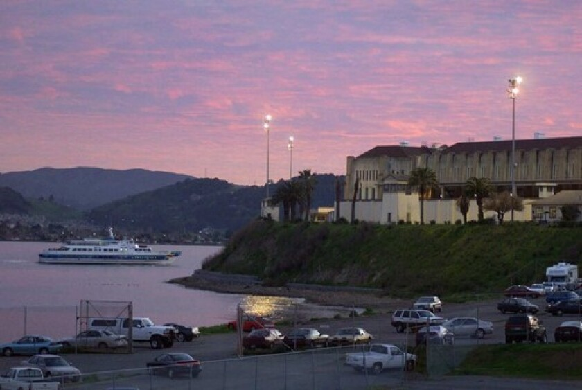 A ferry passes San Quentin State Prison, where more than 1,400 inmates have tested positive for the coronavirus.