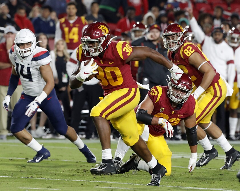 USC's Markese Stepp runs for a touchdown against Arizona in the second quarter at the Coliseum on Saturday.