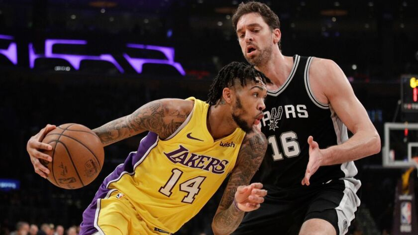Brandon Ingram of the Lakers drives past Pau Gasol of the Spurs during the first half on Thursday.