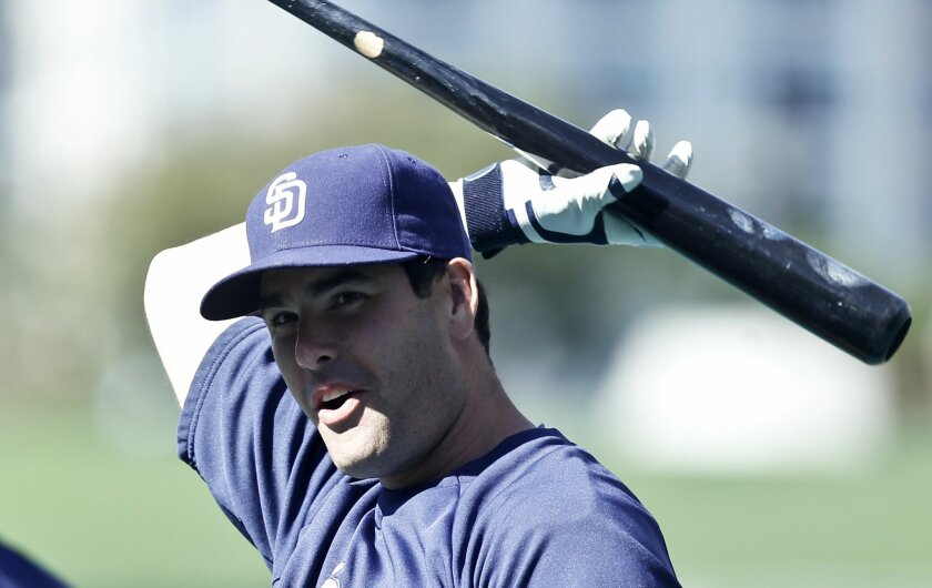 The Padres' Seth Smith gets loose swing a bat during pre game activities before a baseball against the Colorado Rockies Monday, April 14, 2014, in San Diego.