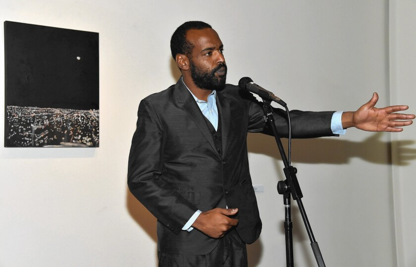 L.A. artist Noah Davis, known for tension-filled scenes of isolated figures and for establishing the Underground Museum, an important artist-run space in Arlington Heights, has died at 32. Here he attends a film event at the museum.
