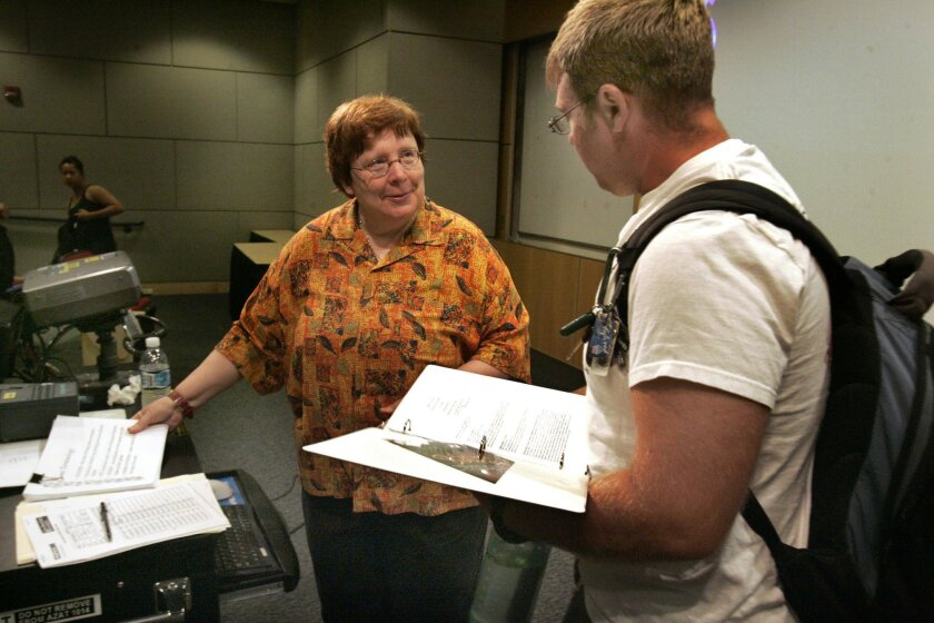 SDSU professor Esther Rothblum talked with student Rich Hollinger after class this month. (John Gibbins / Union-Tribune)