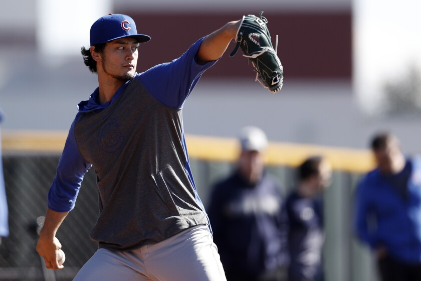 Chicago Cubs pitcher Yu Darvish throws during a spring training baseball workout on Feb. 12 in Mesa, Ariz.