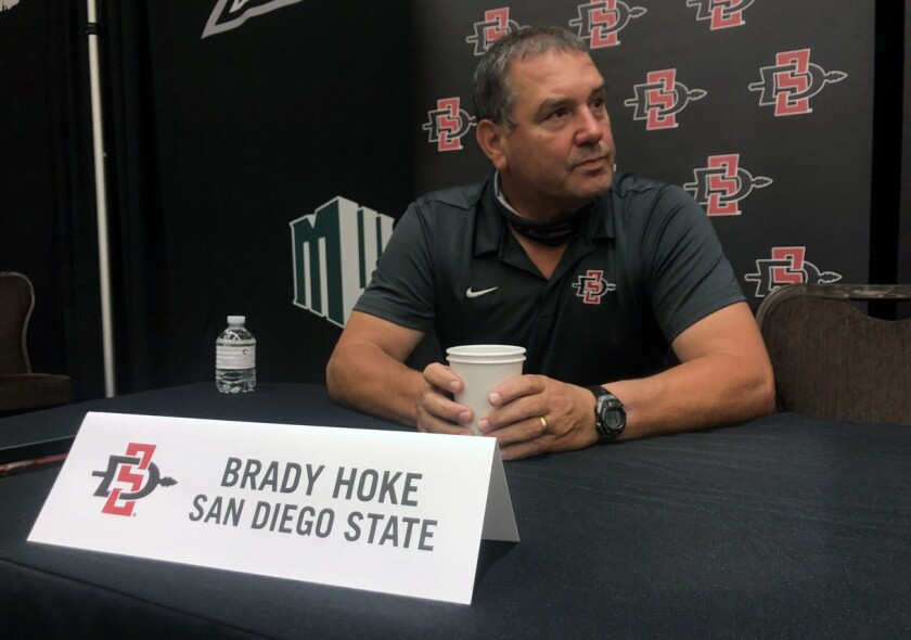 San Diego State head coach Brady Hoke listens to a reporter's question during Mountain West football media days in Las Vegas.