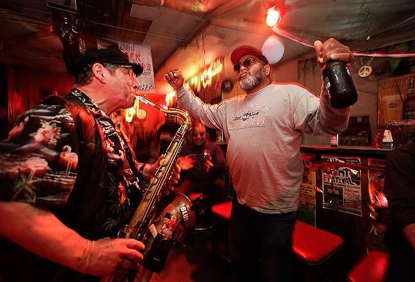 Red Paden, owner of Red's Blues Club in Clarksdale, Miss., grooves with saxophone player Dick Lourie at a tribute to Delta bluesman Big Jack Johnson, who died March 14, 2011.