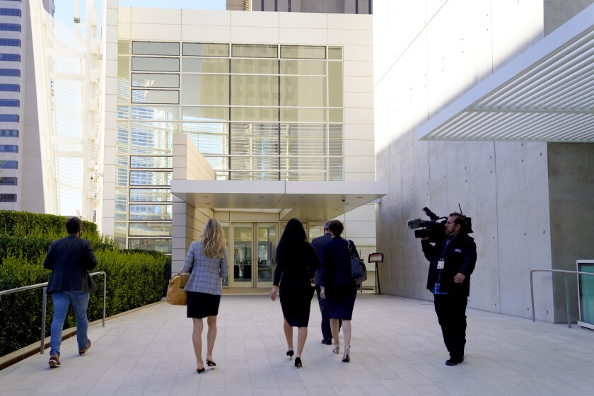 Gina Champion-Cain walked into Federal Court for her sentence hearing for orchestrating the largest ponzi scheme.