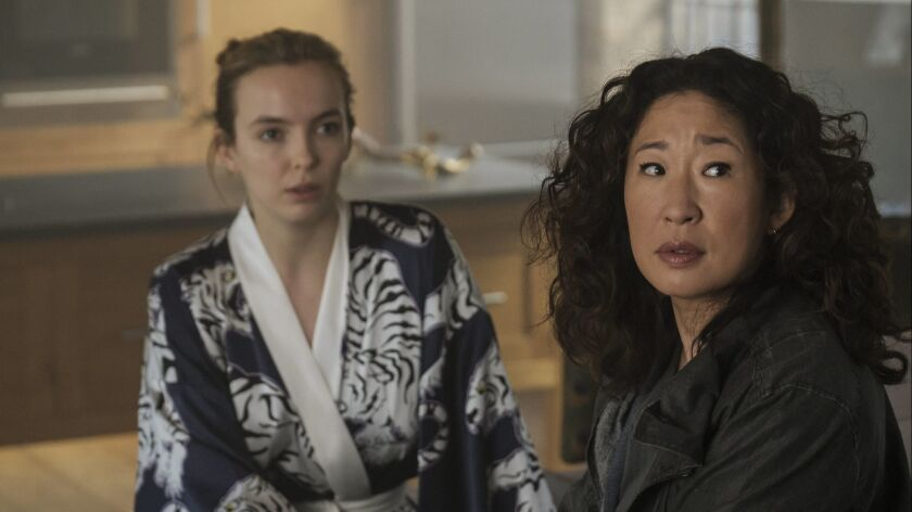 """(L-R)- Jodie Comer as Villanelle and Sandra Oh as Eve Polastri in a scene from """"Killing Eve"""" Season"""