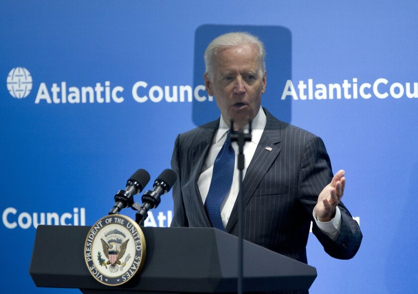 Vice President Joe Biden is seen behind a teleprompter as speaks at the Atlantic Council's conference, in a special tribute to NATO and the European Union, Wednesday, April 30, 2014, in Washington. Biden drew parallels between Russia's interference in Ukraine and the world wars of the last century.