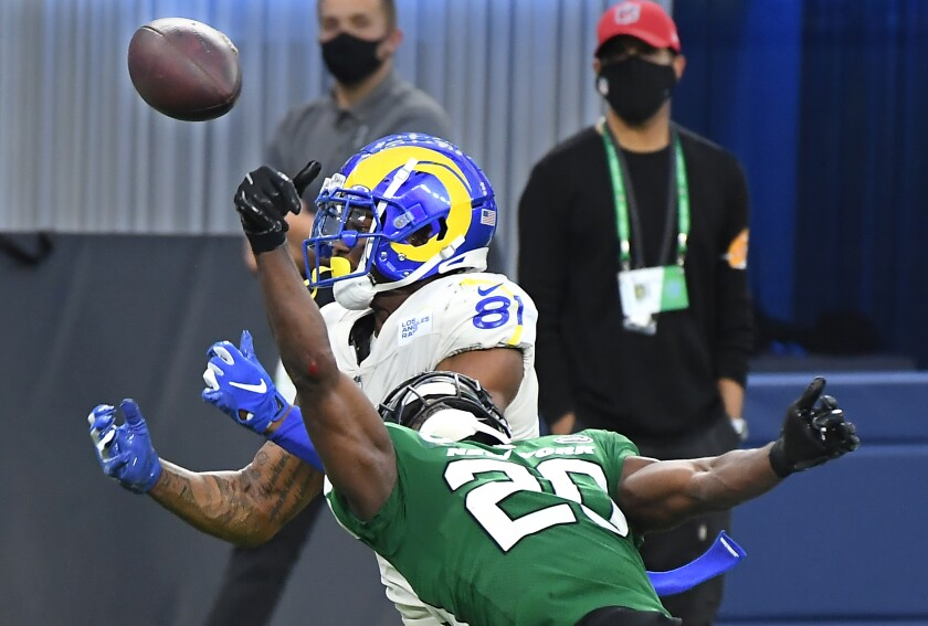 New York Jets safety Marcus Maye knocks the ball away from Rams tight end Gerald Everett.