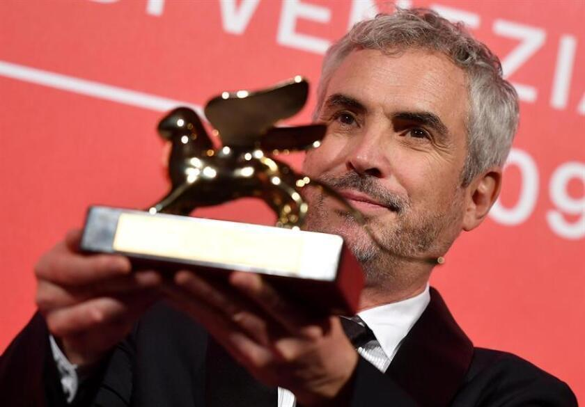 Mexican director Alfonso Cuaron holds the Golden Lion award for his movie 'Roma' during the awarding ceremony of the 75th annual Venice International Film Festival, in Venice, Italy. EFE/EPA/FILE