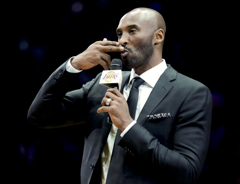 Kobe Bryant speaks during a halftime ceremony retiring both of his Lakers jerseys Dec. 18, 2017, at Staples Center.