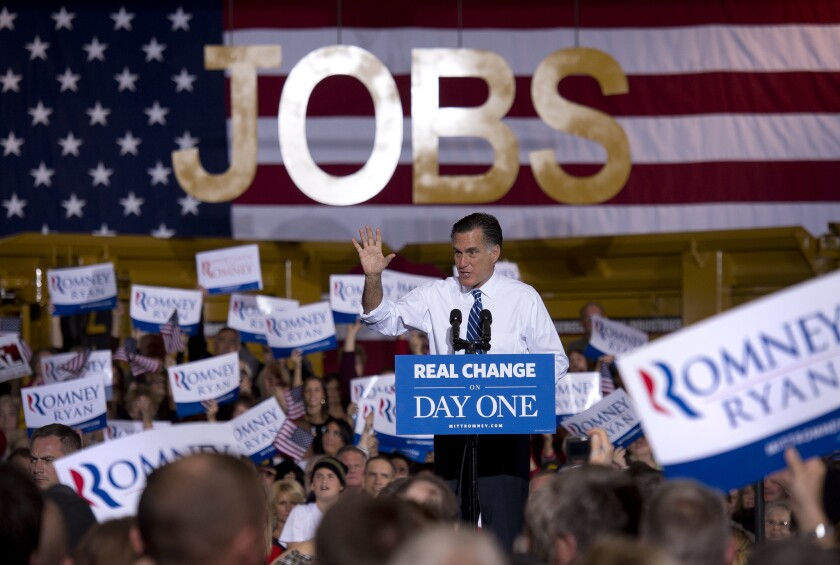 Republican presidential candidate Mitt Romney holds a rally at Screen Machine Industries in Etna, Ohio.
