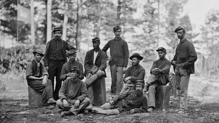 Union soldiers pose during the Siege of Petersburg in Virginia in 1864. A new study of the descendants of Union soldiers shows how the effects of trauma are passed down from generation to generation.