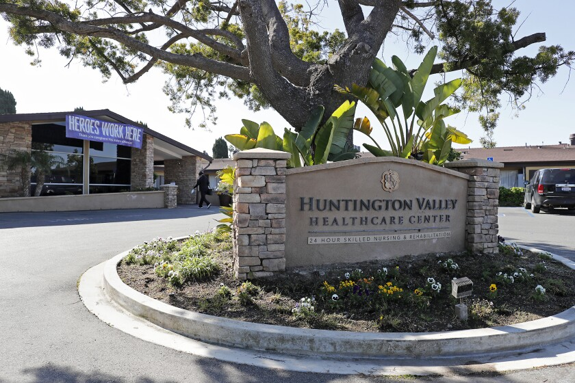 A worker enters the Huntington Valley Healthcare Center in Huntington Beach on April 22. The facility recorded its first coronavirus deaths about a month ago and is one of several in Orange County where residents have died of COVID-19.