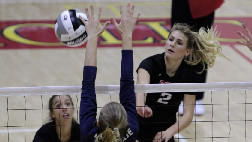 Santa Fe Christian's Abby Phillips gets a shot off against Del Norte's Maddie Harris during San